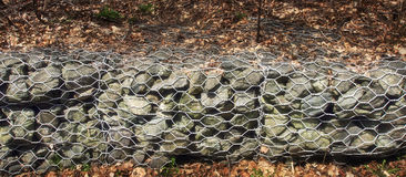 Mesh retaining wall Stock Images