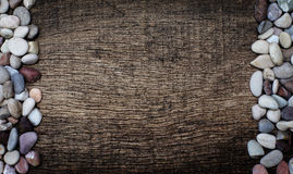 Rock on the right side and the left on the background of wood. Rock on the right side and the left on the background of old wooden cracked Royalty Free Stock Photo