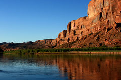 Rock and River. Red rock sandstone formation along Colorado River at sunrise royalty free stock image