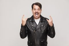 Rock and roll baby! Happines adult man toothy smiling with big e Royalty Free Stock Photography