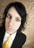 Rock and Roll Businessman with Crossed Eyes Royalty Free Stock Photography