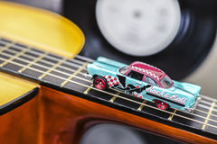 Rock & Roll Car. Vintage Rock & Roll Car Miniature on Guitar Royalty Free Stock Photography
