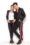Rock and roll couple in leather clothes standing together stock photos