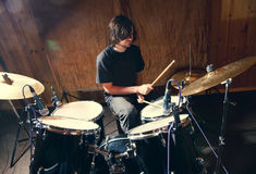 Rock and roll drummer. Drummer playing his kit. Rock and roll drummer Royalty Free Stock Photos