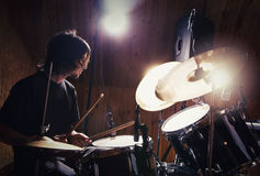 Rock and roll drummer. Drummer playing his kit. Rock and roll drummer Stock Photography