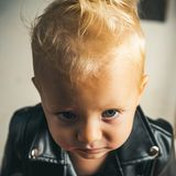 Rock and roll fashion trend. Little rock star. Little child boy in rocker jacket. Rock style child. Adorable small music royalty free stock images