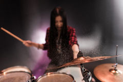 Rock and roll girl playing hard rock music with drums set. Rock and roll young girl playing hard rock music with drums set Royalty Free Stock Photo