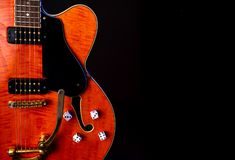 Vintage Electric Guitar, Orange flame maple, 6 String isolated on black royalty free stock images