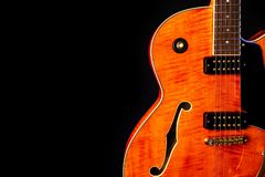 Vintage Electric Guitar, Orange flame maple, 6 String isolated on black royalty free stock image