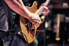 Rock-and-roll. Guys playing rock-and-roll all together. Selective focus Royalty Free Stock Images