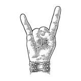 Rock and Roll hand sign. Vector black vintage engraved illustration. Rock and Roll hand sign. Hand with metal spiked bracelet giving the devil horns gesture Royalty Free Stock Image