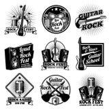 Rock and roll music vector labels. Vintage heavy metal emblems set. Rock music emblem for festival or radio illustration Stock Images