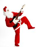 Rock and roll Santa. Santa dancing with guitar and having one leg up in the air. White background Stock Photo