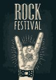 Rock and Roll sign. Vector black vintage engraved illustration. Rock and Roll sign. Hand with metal spiked bracelet giving the devil horns gesture. Vector Royalty Free Stock Photos