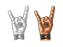 Rock and Roll sign. Vector black vintage engraved illustration. Rock and Roll sign. Hand with metal spiked bracelet giving the devil horns gesture. Vector color Royalty Free Stock Image