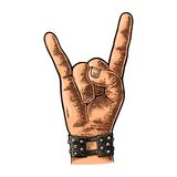 Rock and Roll sign. Vector black vintage engraved illustration. Rock and Roll sign. Hand with metal spiked bracelet giving the devil horns gesture. Vector color Stock Photos