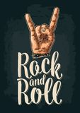 Rock and Roll sign. Vector black vintage engraved illustration. Rock and Roll sign. Hand with metal spiked bracelet giving the devil horns gesture. Vector color Royalty Free Stock Images