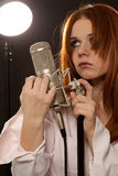 Rock and roll singer with microphone Royalty Free Stock Photo