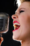 Rock and roll singer with retro microphone Royalty Free Stock Photos