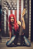 Rock and roll star. Red head rock and roll star sitting on the floor Stock Image