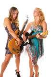 Rock and Roll Women. Rock and Roll girls rocking out on Electric guitar and Bass Royalty Free Stock Photography