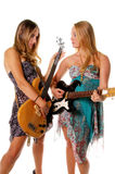 Rock and Roll Women. Rock and Roll girls rocking out on Electric guitar and Bass Royalty Free Stock Photos