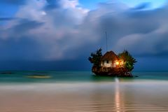 Rock romantic restaurant. In Indian ocean near Zanzibar coastline Royalty Free Stock Photography