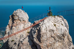 Rock with a rope bridge on the Mount Ai-Petri in Crimea. Rock on the Mount Ai-Petri with a rope bridge in Crimea, Russia. It is one of the highest mountains in royalty free stock photo
