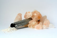 Rock Salt. From Kashmir and a grater used to crumble it over gourmet food stock photos