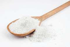 Rock salt in a wooden spoon Stock Photography