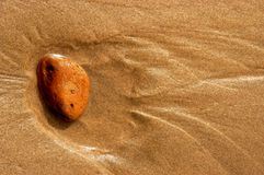 Rock in sand Royalty Free Stock Photography