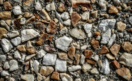 Rock and Sand Aggregate Street for Texture Background. Closeup of Rock and Sand Composite on a Street for Texture Background Stock Image