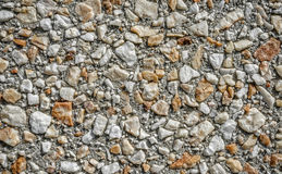 Rock and Sand Aggregate Wall for Texture Background Royalty Free Stock Photos