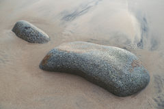 Rock in the sand Royalty Free Stock Photography