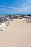Rock, sand, sea and sky Stock Photo