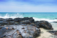 Rock, sand, sea and sky Royalty Free Stock Images