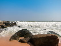 Rock sand and wave. The rock on the beautiful beach Royalty Free Stock Photography