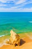 Rock on sandy Praia da Rocha beach Royalty Free Stock Photos