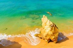 Rock on sandy Praia da Rocha beach Royalty Free Stock Images