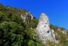 Rock sculpture. Rock sculpture of king Decebal on the bank of Danube River, near the city port of Orsova, Romania. HDR image Stock Image