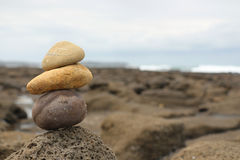 Rock sculpture on a rocky plateau. Rock Sculpture by the side of the sea, sitting on an old lava shelf.  These rocks are basalts, and are located on the East Stock Photography