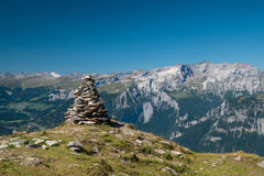 Rock sculpture. A rock sculpture someone made in Switzerland on a mountain peak Royalty Free Stock Photography