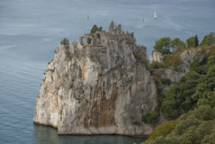 Rock in sea. Big rock in sea at duino, italy stock photography