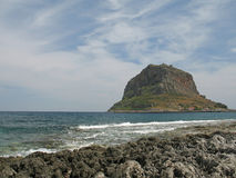 Rock in the Sea. A distant view of the rocky islet castle-town of Monemvasia, Greece stock photos