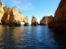Rock in sea. The photo has taken in coast Algarve, Portugal Royalty Free Stock Photos