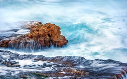 Rock in the sea royalty free stock photography