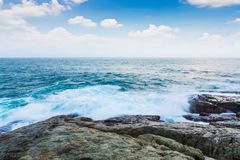 Rock and sea with blue sky Stock Photography