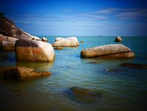 Rock, sea and blue sky - Penang, Malaysia. This is Batu Ferringhi Beach at Penang, Malaysia Stock Photography