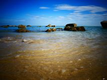 Rock, sea and blue sky - Penang, Malaysia. This is Batu Ferringhi Beach at Penang, Malaysia Royalty Free Stock Photography