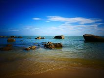 Rock, sea and blue sky - Penang, Malaysia. This is Batu Ferringhi Beach at Penang, Malaysia Royalty Free Stock Images